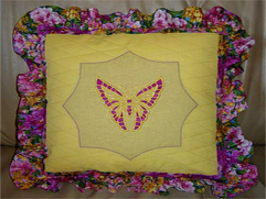 Yellow Cushion with Cutwork Butterflies