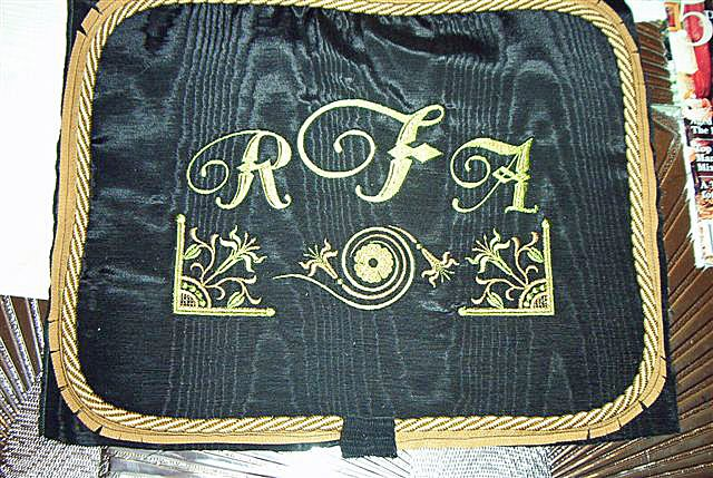 Black Pillow with Castle Embroidery Font and Lovely Lilies