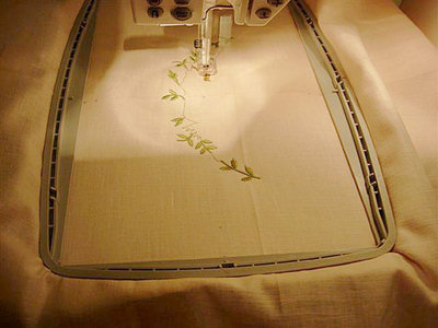 Remove the paper template, and embroider corresponding design.